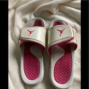 Air Jordan slides pink and white. Size 7Y.